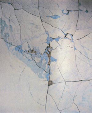 Detail of a painting by Henry Cliffe, painted in 1959, shows severe cracking and interlayer cleavage in paint containing lead white and zinc white.