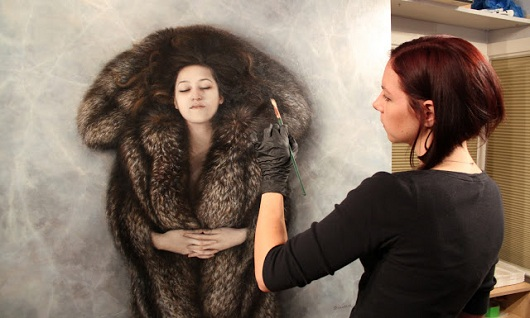 Candice Bohannon putting the finishing touches on a new work, Ice Flow